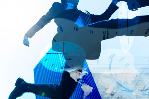 Businessman jumping and clocks