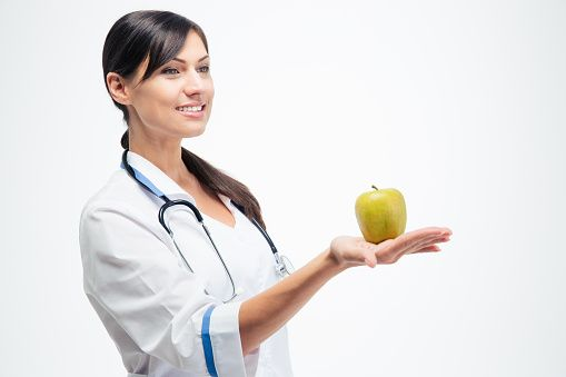 Female doctor holding apple