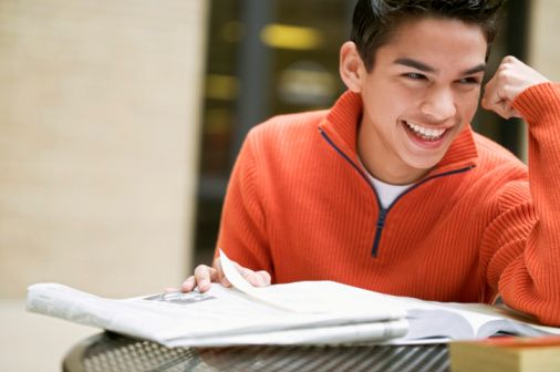 Smiling student studying