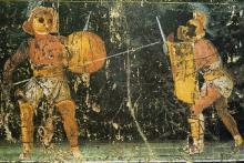 Pintura al fresco representando lucha de gladiadores